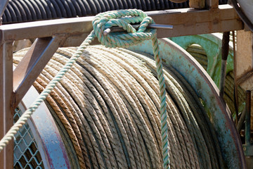 Closeup of drum of old worn hemp rope coils