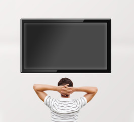 Man watching tv. Photo from behind. Editable copyspace at the sc