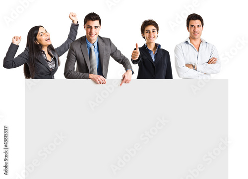 Group of people behind a blank board