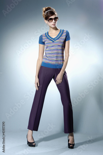 Full length girl with modern hairstyle on light background