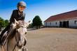 Leinwandbild Motiv Horse riding - portrait of lovely equestrian on a horse