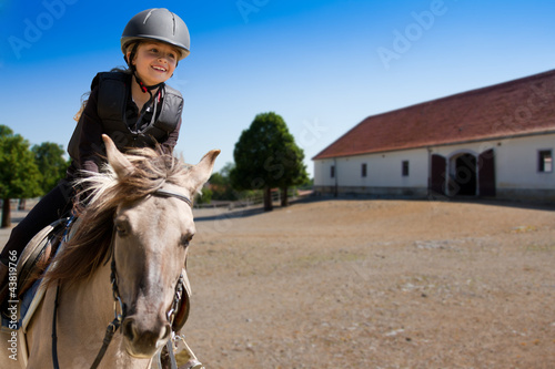 Plexiglas Paardensport Horse riding - portrait of lovely equestrian on a horse