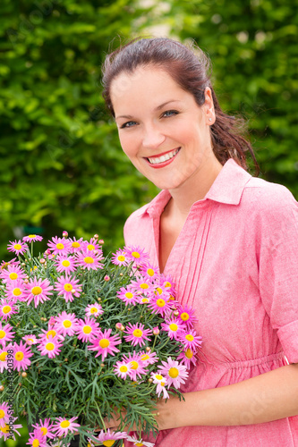Female florist hold pink potted flower