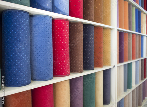 colorful carpets samples on the shelves - 43821312