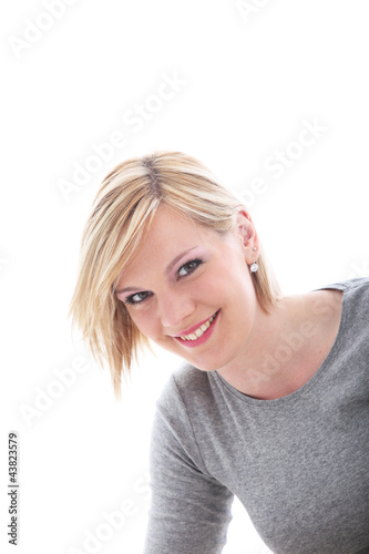 Portrait of smiling blonde isolated on white
