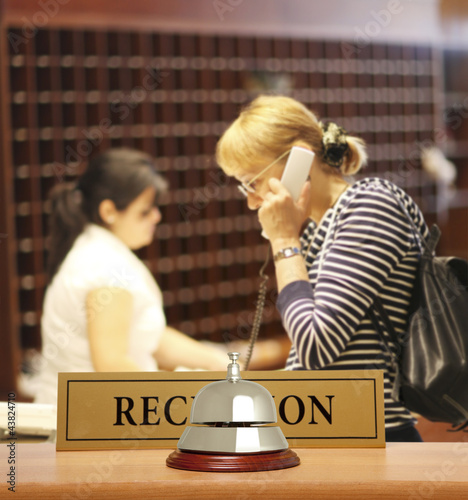 A woman calling on a hotel reception