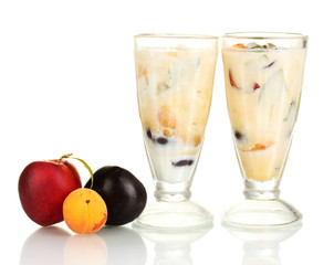 Milk shakes with fruit isolated on white close-up