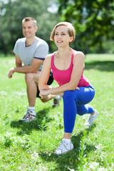 Man and woman doing stretching exercises