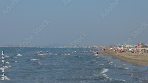 People relaxing on the beach,  Rimini, Italy,