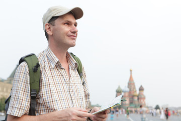 Tourist with a map on Red Square, Moscow, Russia
