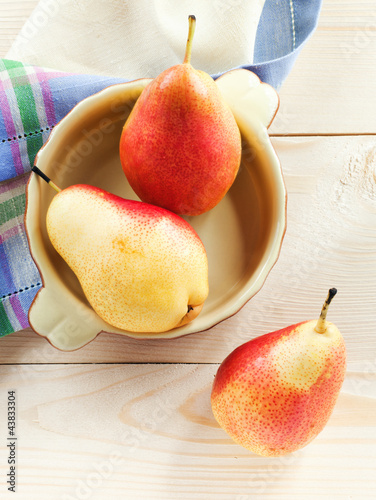 Fresh pears on a wooden table
