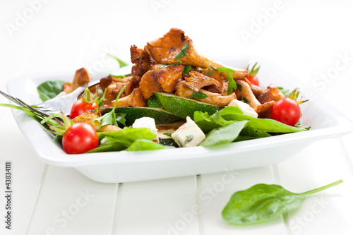 Fresh baby spinach with roasted chanterelle mushrooms