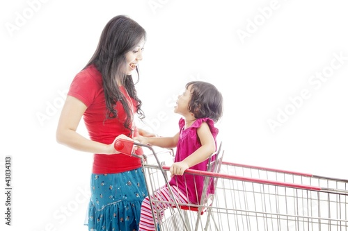 Mother laughing with daughter on trolley