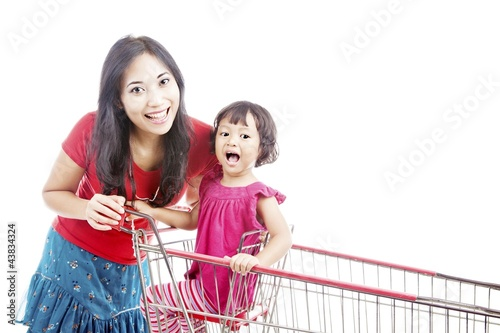 Mother with daughter on trolley