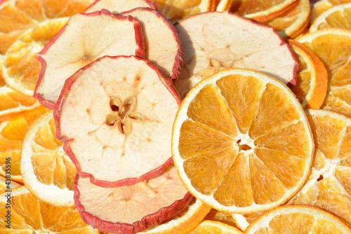 Fotobehang Plakjes fruit Apfel und Orangenscheiben