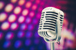 retro microphone on purple disco background