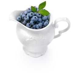 White jug full of blueberries