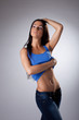 Young woman in jeans undress blue tank top