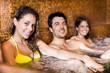 Happy people relaxing in a spa