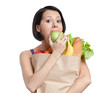 Vegetarian girl eats a green apple, isolated, white background