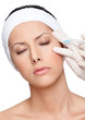 Applying botox eyelid correction, isolated, white background
