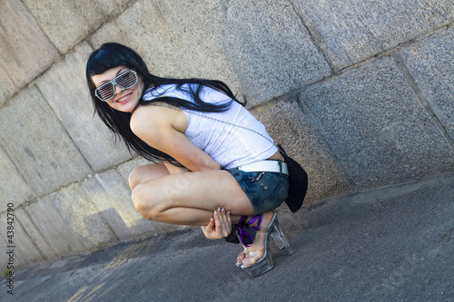 Attractive brunette woman posing in sunglasses