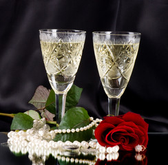 White vine glass with red roses and beads