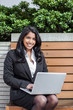 Indian businesswoman with laptop