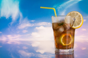 Long Island iced tea glass with summer sky background
