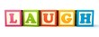 Alphabet building blocks that spelling the word laugh