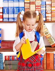 Child with stack book.