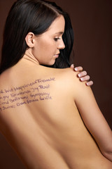 the back of a young woman with text