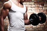 Muscular guy doing exercises with dumbbell - 43851320