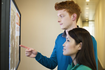 Business people looking at display screen