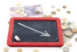 Decrease arrow down on blackboard with polish money poster