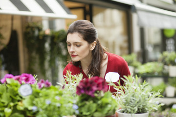 Woman smelling flowers in a flower shop