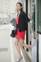 Woman exiting from a bus
