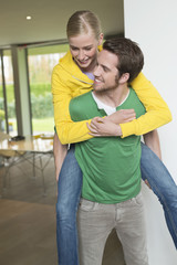 Woman riding piggyback on her boyfriend