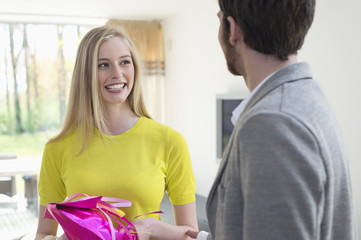Woman receiving gift from boyfriend
