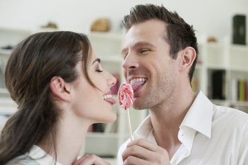 Couple sharing a candy