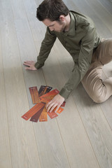 High angle view of a man choosing laminate boards