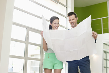 Couple reading a blueprint