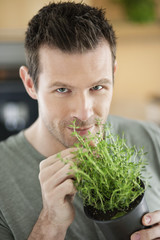 Man smelling thyme plant