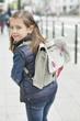 Schoolgirl walking on a footpath