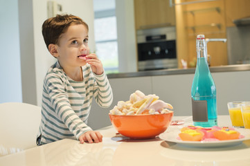 Boy eating snack