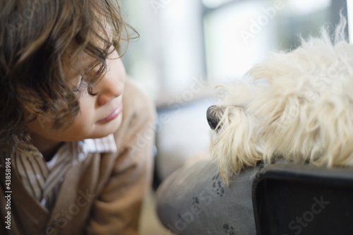 Close-up of a boy looking at a dog