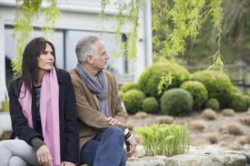 Couple sitting in a garden