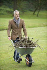 Man collecting firewood in a park