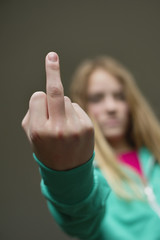 Girl showing middle finger