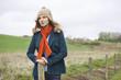 Beautiful woman standing in a field